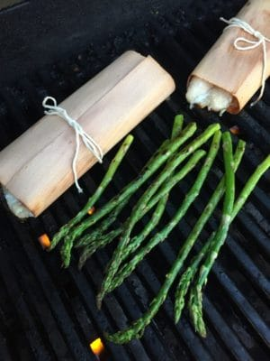 Easily grill asparagus with the wrapped fillets for an easy meal.