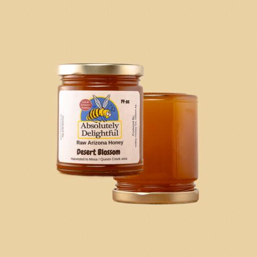 Two crystallizing desert blossom honey jars floating